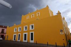 Yellow building, Puebla, Mexico, October/ November 2016 (Yekkes) Tags: mexico puebla architecture yellow clouds darksky windows squarewindows slope