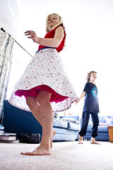 Showing off the Party Dress 1 (C & R Driver-Burgess) Tags: spin flare flair skirt polka dot red tulle petticoat slip bodice blonde hair whirl twist twirl child girl boy kids hikey over exposed blue couch settee inside cousins lounge