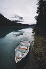 Row the boat. (Bokehm0n) Tags: landscape nature vsco explore flickr earth travel folk 500px vscofilm canada emerald lake sunrise water no person watercraft vehicle transportation system river reflection outdoors boat daylight rowboat recreation sky tree mountain