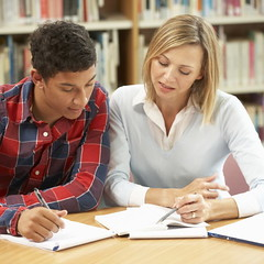 College tutor with student (teamgivingsacramento) Tags: 2 academic adult adulteducation assessment books boy casual caucasian college collegestudent collegestudents coursework desk discussing education essay explaining female further happy happystudents higher highereducation horizontal individual indoors informal library librarybooks male man mixed office one people peopletalking portrait professor pupil race sitting smiling student talking teach teacher teacherandstudent teen teenage teenageboy teenboy thirties tuition tutor twopeopletalking university universitystudents woman womentalking working young
