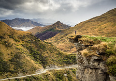 Exploits along Skippers Road (loveexploring) Tags: newzealand otago skipperscanyon skippersroad southisland southernalps cliff cloudy dramaticscenery landscape mountains person road tussock viewpoint
