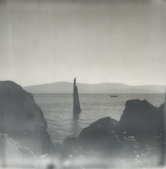 Through the mist and after the waves (Celina Innocent) Tags: impossibleproject colorframe blackandwhite instantfilm oregoncoast water shore rocks bird boat fisherman polaroidweek sx70