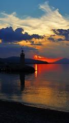 P1070923 (omirou56) Tags: 169ratio panasoniclumixdmctz40              sea sky sunset silhouette clouds reflection lighthouse aigio achaia greece hellas peloponnisos peloponnese peloponisos