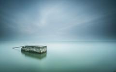 The block (marcolemos71) Tags: seascape sea water concret chain block sky clouds longexposure bridge lisbon portugal