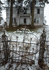 Northcraft House (Rodney Harvey) Tags: abandoned house missouri snow wrought iron fence gate spooky old cold