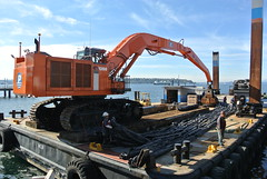 Barges will be moored near the seawall while we deposit rocks to install intertidal habitats. (Seattle Department of Transportation) Tags: seattle sdot transportation seawall progress october 2016 waterfront barge machine intertidal habitats rocks construction heavy lift environment