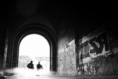 entering (maekke) Tags: zrich puddlegram reflection man graffiti availablelight pointofview pov fujifilm x100t switzerland ch 2016 bw noiretblanc streetphotography