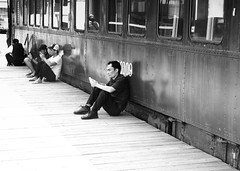 Pier 21 (halifaxlight) Tags: canada novascotia halifax pier21 museumofimmigration immigrants traincarriage men sitting waiting cellphone mobilephone bw shadows reflection