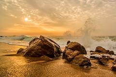 Golden D'light (Navin.Images) Tags: sea sun seascape beach sunrise rocks waves vizag andhrapradesh rkbeach