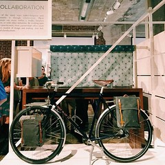 My bike's in an art gallery! (guidedbybicycle) Tags: art leather bicycle creativity design gallery asheville steel north craft center exhibit exhibition canvas made carolina touring waxed capricorn wnc panniers cccd