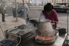 Castanhas assadas (Cbbyosoy) Tags: street autumn woman fall portugal fire lisboa lisbon otoo castaas chesnuts castanhas