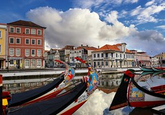 Picturesque town Aveiro built on a networks of channels (Bn) Tags: portugal aveiro moliceiros boat gondel traditionally charm magic hidden gem reflections water canals maritime colour fishermen paintwork azulejo fishing veice lagoon urban festival seaweed tourist holiday vacation pink yellow colors blue round city hopping ornate images man woman clouds weather after rain eusebio picturesque built networks channels gondelas