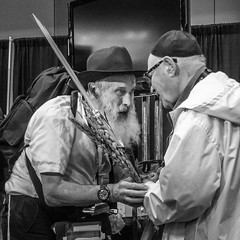 """Shalom, old friend!"" (John St John Photography) Tags: photoplusexpo streetphotography candidphotography men friends people peopleofnewyork jewish shalom peace friendship shaking hands javitscenter 12thave newyorkcity newyork blackandwhite blackwhite bw"
