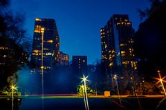Apartments at Twilight (VBuckley.com) Tags: twilight mckinley mckinleymarina pond downtown milwaukee wisconsin skyline night canon fall leaves urbanpark park blue longexposure lightstreaks
