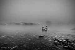 Fog and Ice (explored) (JustAnotherCanonOperator (JACO)) Tags: autumn samyang14mm water bw jkulsrln lake wet iceland monochrome glacial longexposure mono lagoon ultrawide blackandwhite iceberg glacier
