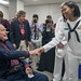 Sailor meets President George H.W. Bush during a military appreciation at Texas A&M University.
