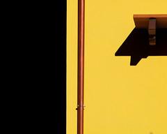 dietro l'angolo (Rino Alessandrini) Tags: ombre contrasto colori giallo nero forme geometria urbano astratto minimalista composizione casa muro facciata grondaia tubi rame buio nascosto rettangoli luci linee tubo shadows contrasting colors yellow black shapes abstract urban geometry minimalist composition house facade wall gutter pipes copper dark hidden lights rectangles tube lines