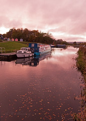 Barges on the Forth and Clyde Canal (AnneMarie Sharkey) Tags: nikond3200 scotland reflections water barges huts colour leaves canal falkirk falkirkwheel forthandclyde dusk