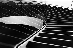 Reflecting stairs (Maerten Prins) Tags: blackandwhite white abstract black reflection netherlands glass monochrome lines museum stairs composition stair curves nederland indoor stairwell minimal line curve rhythm zwolle fundatie