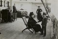 Emmeline Pankhurst talking to a small boy, c.1913-1914.