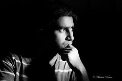 Another Self Portrait (abhishek.verma55) Tags: selfportrait self thinking canon550d tamron2470 tamron blackandwhite strobe strobist lights lightandshadow indoor flash flashphotography blackwhite bw yongnuo monochrome flickr photography directionallight blackbackground black experiment light ©abhishekverma thought selfie