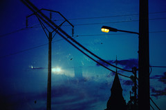 Driving into the blue night (Lux Obscura) Tags: multiple triple exposure casinography blue electric pole lights wires clouds swallows daynight cars strange surreal trees road nocrop noedit nuart