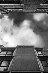 Face Off. (ThePhotographersRepublic) Tags: brutalism brutalistarchitecture architecture blackandwhite clouds lookup