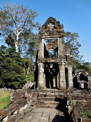 an architectural oddity (SM Tham) Tags: asia cambodia angkor unescoworldheritagesite preahkhan khmer stone temple architecture building columns steps plinth gable basreliefs stonecarvings trees outdoors
