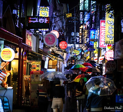 A rainy night in Hongdae (gunman47) Tags: 24105 24105mm asia hongik korea korean rok republic seoul south alley alleyway day hongdae landscape neon night photography rain rainy sign signs street umbrella university     southkorea