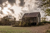 Dark Barn (Brian Schuessler) Tags: stormclouds storm rural rot country barn old metalroof woodbarn clouds sky outdoor landscape rainclouds nature sun light abandoned autumn fall rain dark nikond5500 tamron16300 rusty contrast ominous