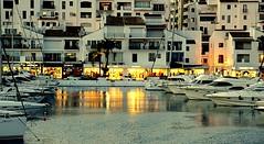 Tiendas del puerto (camus agp) Tags: puertos barcos reflejos marbella españa pantalan atraques fachadas