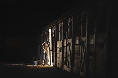 barn light (lindy.pfaff) Tags: shadows light lindypfaff lindy pfaff barn horse dark farm girl small child riding english stable evening