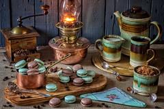 Coffee & Home Made Macarons (memoryweaver) Tags: kerosene paraffin light lamp oillamp copper embroidery napkin stilllife spoons sugar grinder beans chocolate wood olive pottery pot mug vintage coffee macarons memoryweaver brilliant