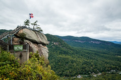 chimney rock (almostsummersky) Tags: autumn hike flag overlook flagpole fall stairs trees mountainrange roundtopmountain rumblingbaldmountain american range chimneyrock northcarolina staircase blueridgemountains clouds cloudcover chimneyrockstatepark rock cloudy mountains highway forest morning statepark cliff fog sign hickorynutgorge appalachianmountains mountain lakelure unitedstates us