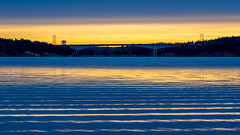 Ripples and Lines (Jens Haggren) Tags: olympus em1 sea seascape water reflections ripples sky clouds colours bridge trees landscape view nacka sweden jenshaggren