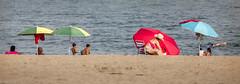 Sun bathing (kaifr) Tags: summer sun beach andaluca spain es bathing umbrellas marbella