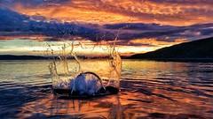 Breaking the Stillness (Mark.L.Sutherland) Tags: cameraphone sunset sky orange skye water clouds reflections evening scotland highlands dusk samsung smartphone ripples splash sutherland westcoast applecross phoneography androidography galaxys5 enteredinsyb brakingthestillness