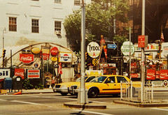 taxi cabs in New York (eatmymoto) Tags: city red summer urban usa newyork hot america ads advertising big market taxi yellowcab 1999 advertisement pepsi cocacola werbung independenceday reklame overload consum summer1999 urbix