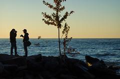 David and Sasha on the Rocks (JeffStewartPhotos) Tags: morning toronto ontario canada beach earlymorning photographers photowalk beaches lakeontario shooters bythewater davidw bythelake sashaf walkingwithdavidw
