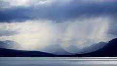 Iceland Long View (loddeur) Tags: ijsland landschap landscape longview weather rain clouds tele sea bay coast mountains shower iceland tamron70300