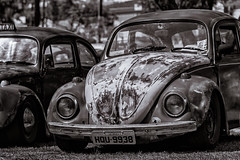 Rusty Beetle (WR Takiguchi) Tags: old volkswagen festival car city beetle nikon sigma retro nostalgia brazil brazilian aircooled fusca taxi bauru mechanic drive wheel tire monochromatic automobile daylight light d3200 travel trip engine motor sunnyday weekend photo adobe nik blackandwhite photography collection hobby contrast bright headlight vintage look