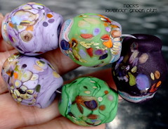 Rocks Lavender Green Plum (Laura Blanck Openstudio) Tags: openstudio openstudiobeads glass handmade murano lampwork torched beads bead set big artist art arts fine artisan made usa rocks pebbles stones frit whimsical funky odd earthy organic abstract colrful multicolor lilac grape lavender purple violet jewelry published show winner festival italian argentinian matte glow opaque frosted etched green copper sienna brick coral orange ocher red eggplant plum