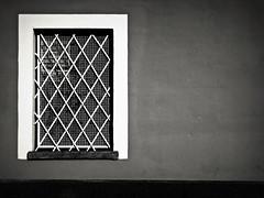 la libert negata (Rino Alessandrini) Tags: finestra muro grata inferriata geometria astratto forme bianco nero contrasto facciata abitazione sbarre chiusura geometrie urbano impedimento privazione divieto window wall grille railing abstract shapes black white contrast geometry home front bars closing forms geometries urban deprivation impediment ban
