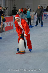 Stephen Smith gets some help with a penguin (James O'Hanlon) Tags: santadash santa dash katumba liam smith paul stephen liamsmith paulsmith stephensmith alankennedy philipolivier tinhead alan kennedy btr juliana ritchie photo shoot press ice rink icerink lfc