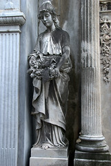 Statue of girl outside a tomb (VinayakH) Tags: tombs tomb recoletacemetery recoleta larecoletacemetery cemetery buenosaires graves argentina latinamerica southamerica mausoleum artnouveau artdeco neogothic baroque architecture