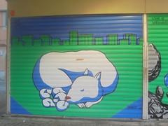 gusto nudo (en-ri) Tags: fracesco cornacchia bologna wall muro graffiti writing lupa wolf serranda 2016 verde blu cuccioli puppets grattacieli