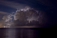 On the Edge of Yesterday (Eye of the Storm Photography) Tags: lightning lightningstrike night clouds thunderstorm italy nikond90 water stars sky