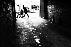 (formwandlah) Tags: kaiserslautern sunny day winter street photography streetphotography silhouette silhouettes silhouetten shadow schatten dark noir urban candid city strange gloomy cold sureal bizarr skurril abstract abstrakt melancholic melancholisch darkness light bw blackwhite black white sw monochrom high contrast ricoh gr pentax formwandlah thorsten prinz licht shadows fear paranoia einfarbig schwarzer hintergrund nacht fotorahmen pedestrians fusgänger wheelchair rollstuhl bricks brick wall