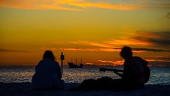 Enjoying the Sunset (claudeallaert) Tags: 135mm carlzeissjena135mm35 clearwaterbeach cruise cyj eveningsun florida guitar gulfofmexico manualfocus pirateship relaxing sonyilce7 sunset vintagelens
