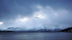 head in the clouds (lunaryuna) Tags: winter light mountain cold nature weather norway season fjord lunaryuna cloudscape waterscape northernnorway ullsfjorden tromsfylke arcticregion lyngenalps seasonalwonders winterabovethearcticcircle